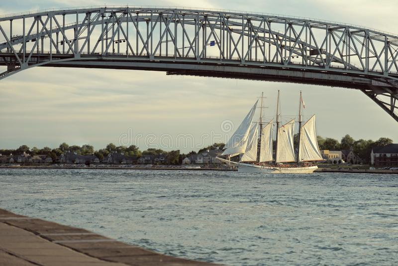 Bluewater bridge with tall ship in Sarnia ontario canada. In the evening stock image