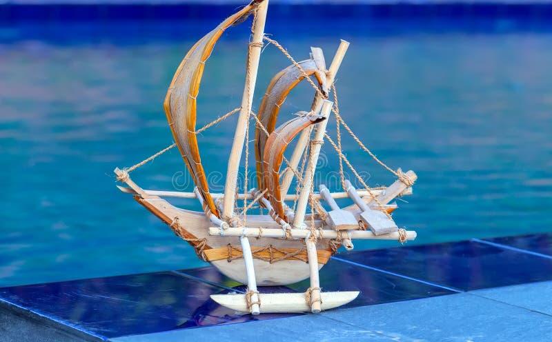 Bluewater pool beach sail fishing boat. Traditional souvenir sail fishing boat from Sri Lanka Bluewater Sailing pool beach stock photography
