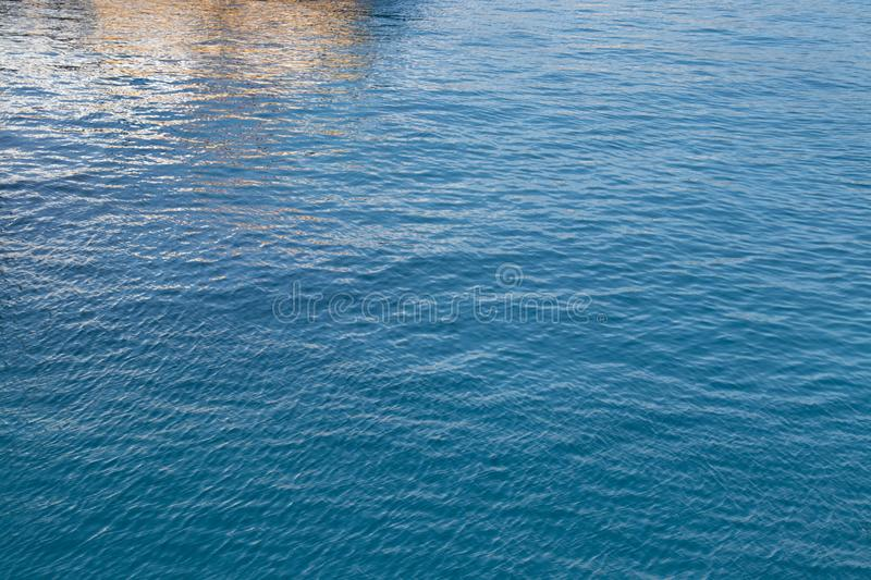 Bluewater of the sea, reflected. Background of abstract seawater in Italy. Azure color. Summer background. Background for your design stock photos