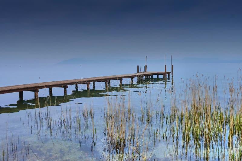 Pier on Garda lake, sun set. royalty free stock image