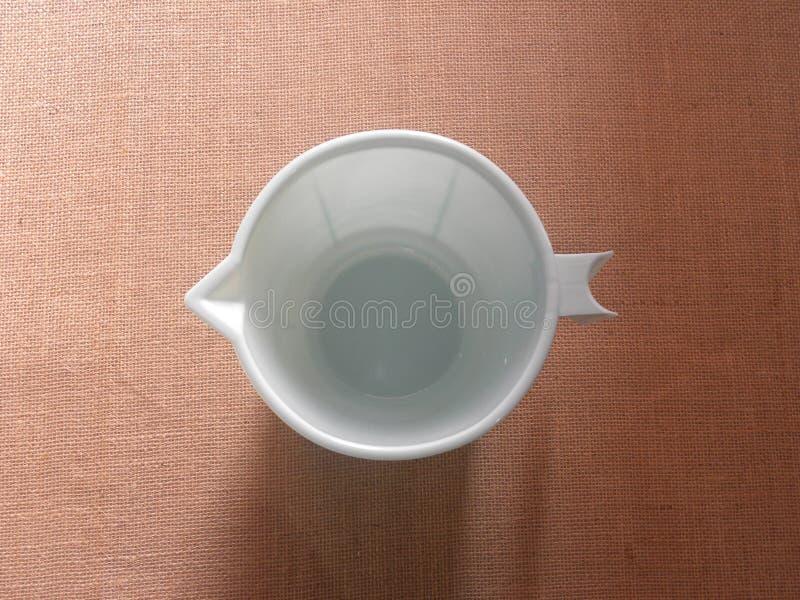 Bluish white color plastic mug royalty free stock image