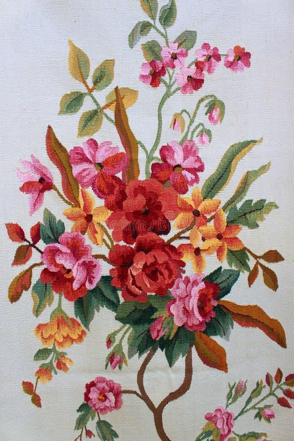 Blume auf Textiloberfläche stockfotos