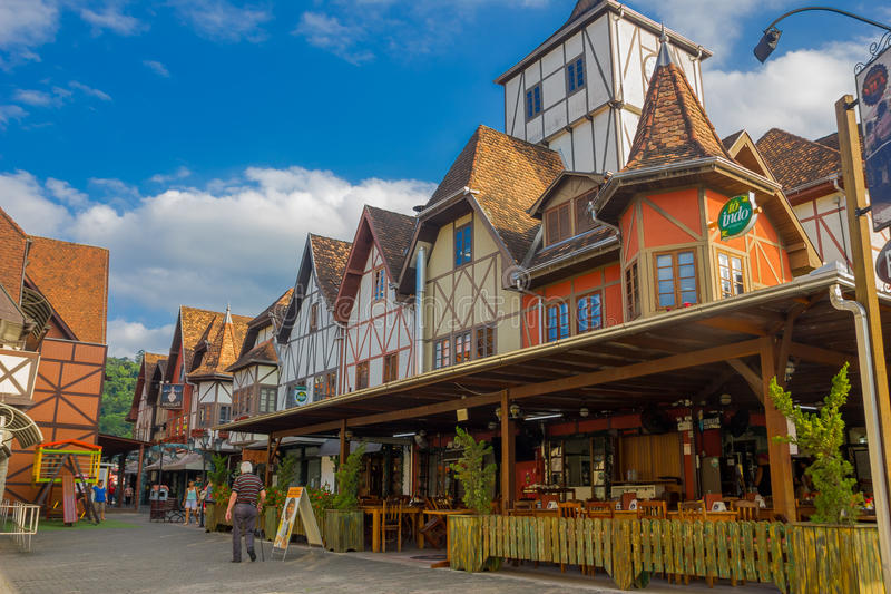 BLUMENAU, BRAZIL - MAY 10, 2016: nice local restaurant in the corner of the street, german style houses.  stock photos