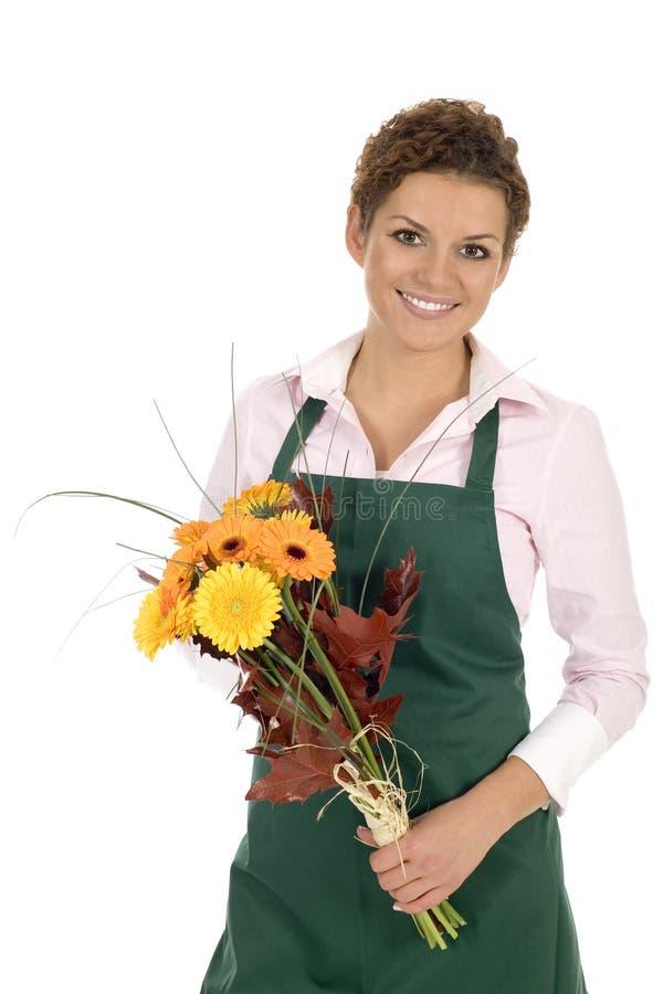 Blumenhändlerholdingblumen lizenzfreie stockfotos