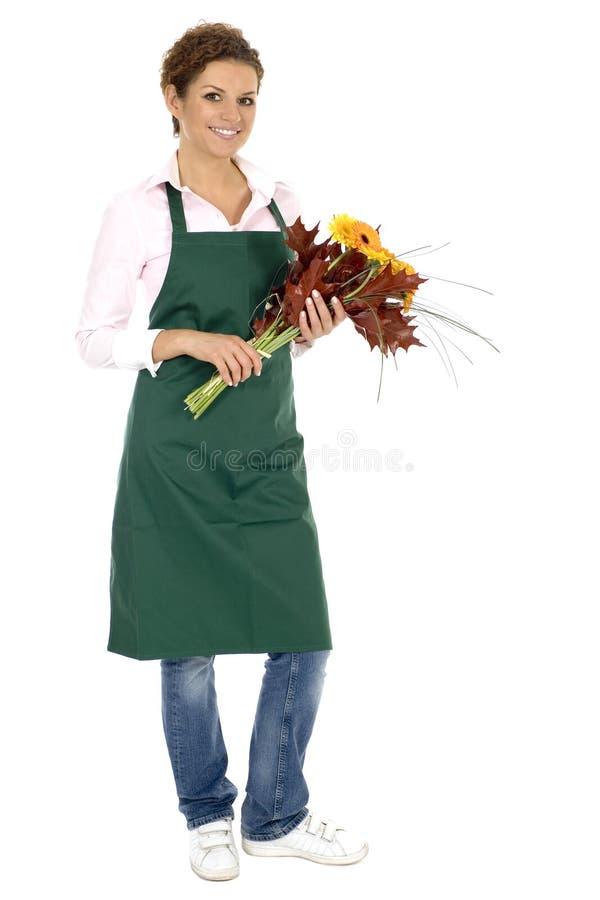 Blumenhändlerholdingblumen lizenzfreies stockfoto