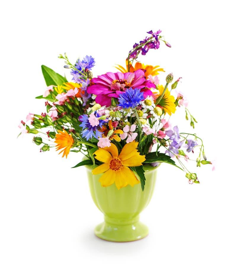 Blumenstrauß der Blumen im grünen Vase lizenzfreies stockbild