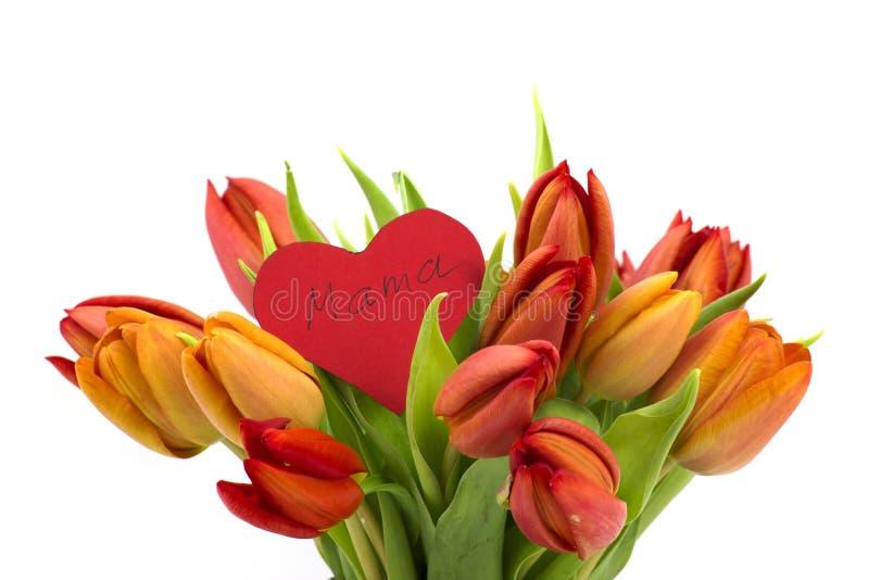 Blumenstrauß von Tulpen und von Herzen lizenzfreie stockfotografie