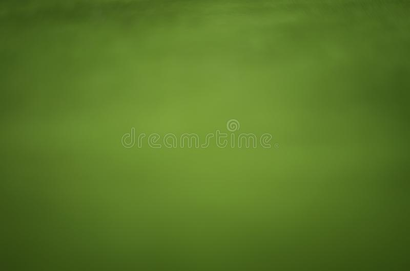 Blur abstracted light green background, old velvet material. stock photo