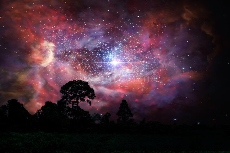 Blur ancient stardust nebula back on night cloud sky over silhouette forest. Blur ancient stardust nebula back on night cloud sunset sky over silhouette forest royalty free stock images