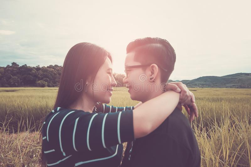 Blur. Asian,Romantic couple or Homosexuality, female love hug on the rice field with sunset, Valentine`s Day love concept. Blur. Asian,Romantic couple or royalty free stock image