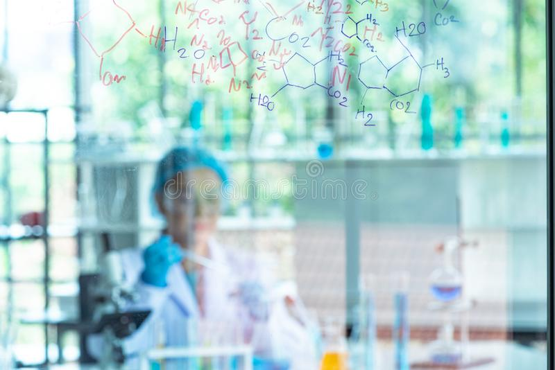 Blur Asian woman scientist, researcher, technician, or student conducted chemistry research in laboratory stock photography