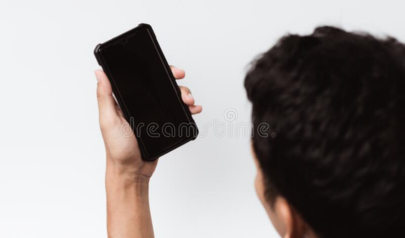 Asian person holding a mobile smartphone. Blur background for graphic design. Blur background for graphic design. Asian person holding a mobile smartphone royalty free stock photo