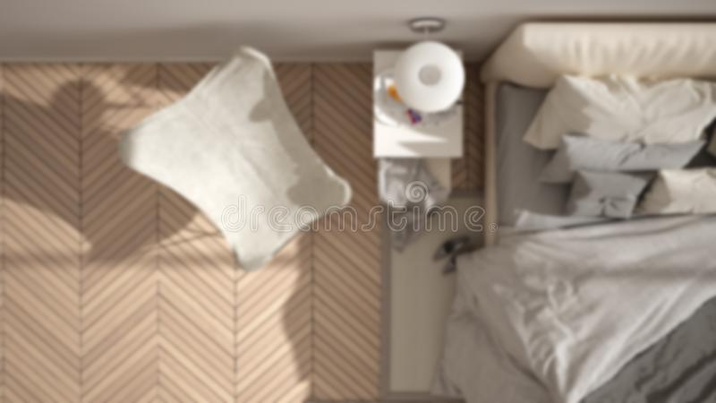 Blur background interior design: minimalist bedroom, bed with pillows and blankets, parquet, bedside tables and carpet, top view royalty free stock photos