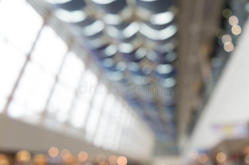 Blur background interior view looking out toward to empty office lobby. And entrance doors and glass curtain wall royalty free stock photos