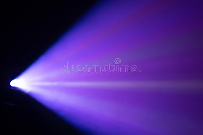 Blur beautiful blue color wide lens projector with light beam for movie and cinema at night . smoke texture spotlight . effects stock photo