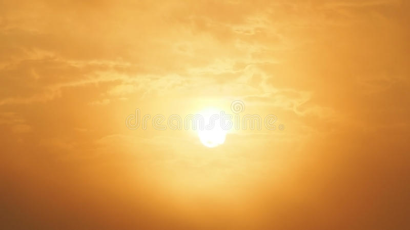 Blur beautiful sun and orange sky. Sunset sunrise in background. Abstract orange sky. Dramatic golden sky at the sunset background.  stock photo