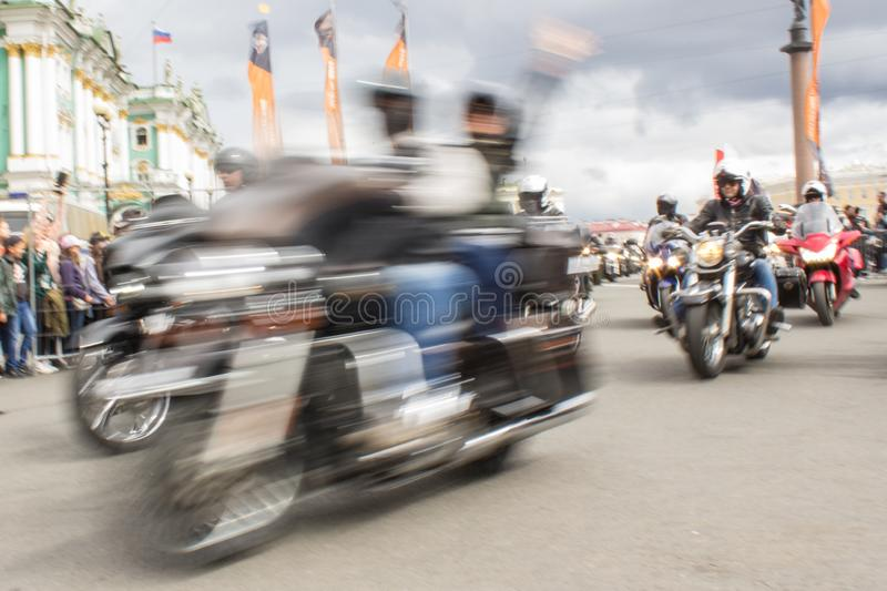 Blur bikers on a motorcycle stock image