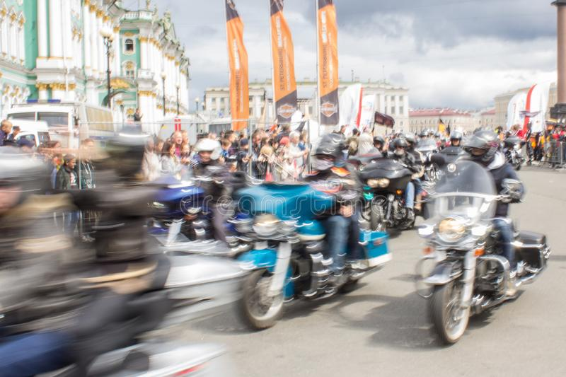 Blur bikers on a motorcycle royalty free stock image