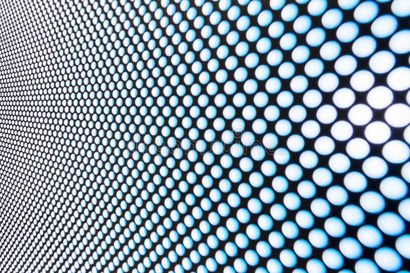 Blur blue abstract background on based of metal, circles and shadows, texture of the white surface with a lot of round holes royalty free stock photos