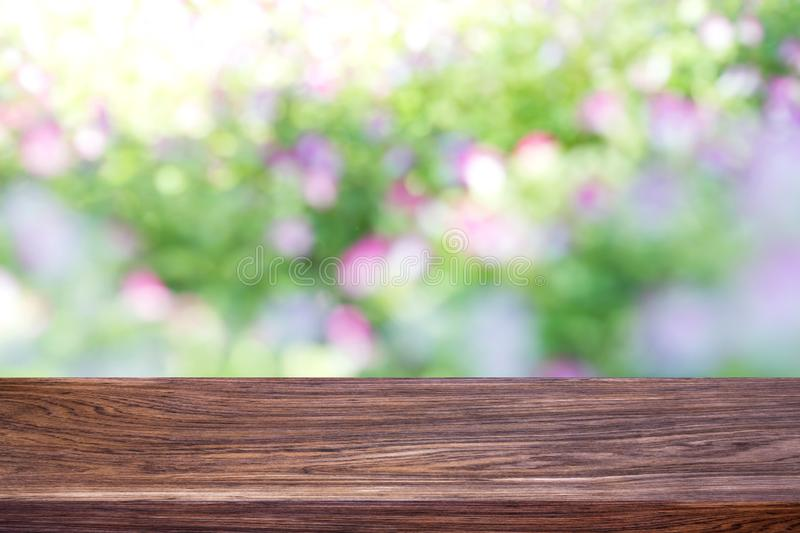 Wood table top on bokeh green bright background. stock images