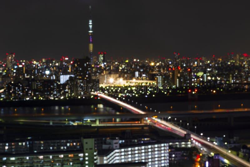 Blur and bokeh ligh of Tokyo skytree tower in Janpan in night li. TOKYO ,JAPAN - OCTOBER 12: Blur and bokeh ligh of Tokyo skytree tower in Janpan at night light royalty free stock photo