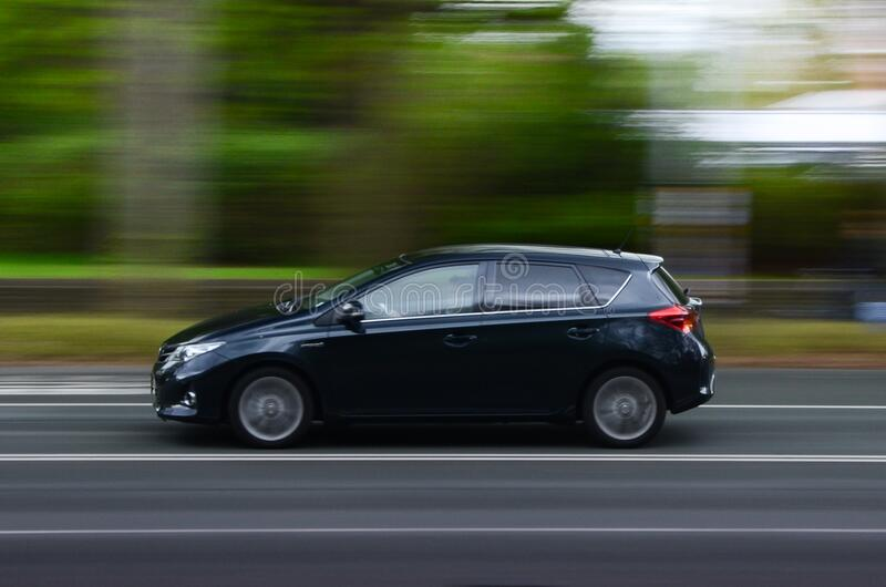 Blur of car driving on road stock image