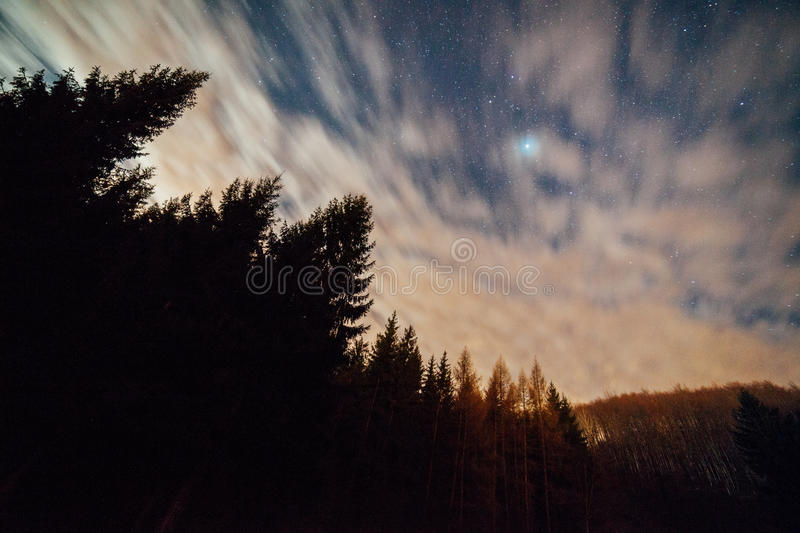 Blur of clouds in night sky stock images