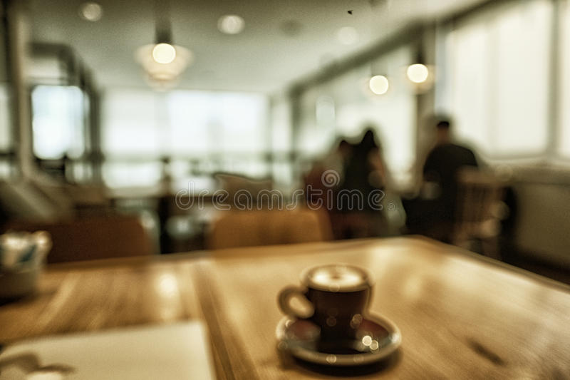Blur coffee shop or cafe restaurant with abstract bokeh light image background. For create montage product display. With color effect stock photo
