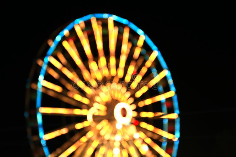 Blur colors light beam of fluorescent light colorful in dark for festival temple fair background, lighting beam in carnival. The blur colors light beam of royalty free stock photos