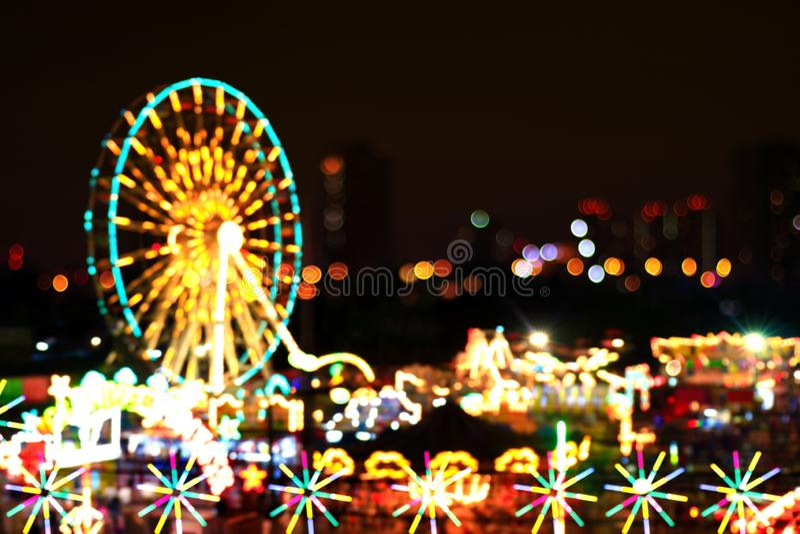 Blur colors light beam of fluorescent light colorful in ferris wheel festival temple fair night background, lighting beam. The blur colors light beam of stock photos