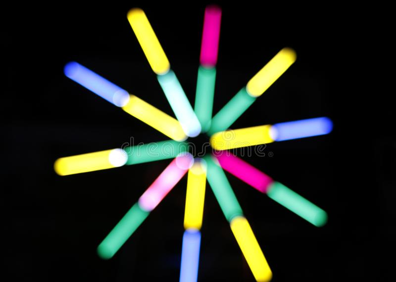 Blur colors light beam of fluorescent light colorful in dark for festival temple fair background, lighting beam in carnival. The blur colors light beam of royalty free stock images