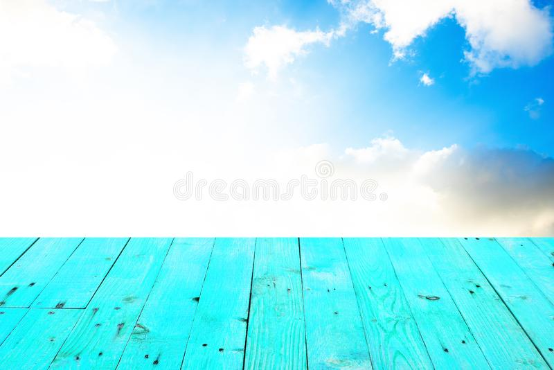 The blur cool blue sky white cloud with old Wooden table stock photos