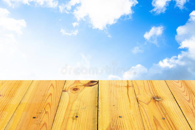 The blur cool blue sky white cloud with old Wooden table royalty free stock images