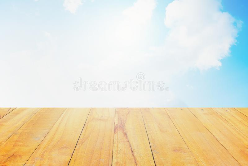 The blur cool blue sky white cloud with old Wooden table stock image