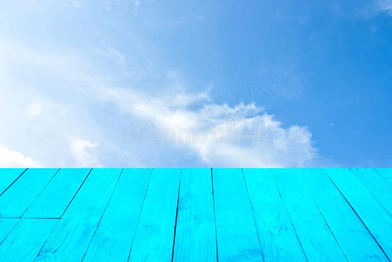 The blur cool blue sky white cloud with old Wooden table foreground stock image