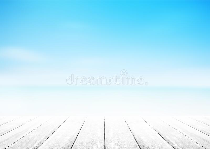 The blur cool sea background with wood floor foreground on horizon tropical sandy beach; relaxing outdoors vacation with heavenly royalty free stock image