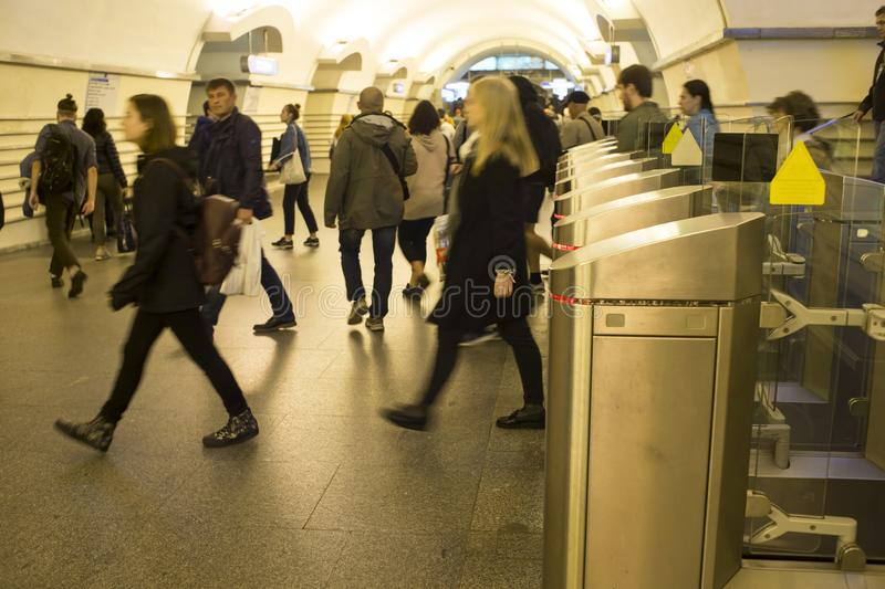 Blur. A crowd of people in a hurry passes through electronic turnstiles at the metro station in St. Petersburg, Russia, September stock photography