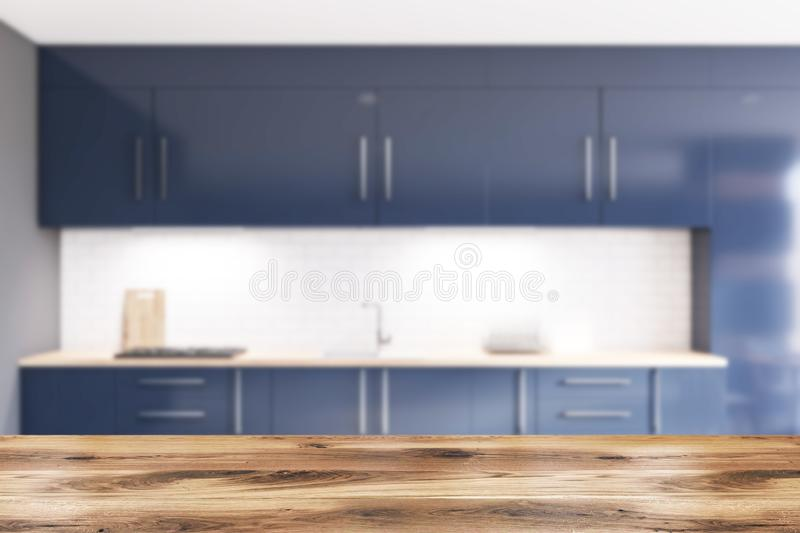 Blur gray and brick kitchen with blue countertops royalty free illustration