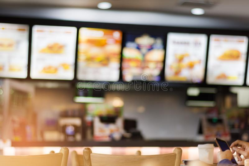 Blur image of fast food restaurant, use for defocused background.  royalty free stock photography