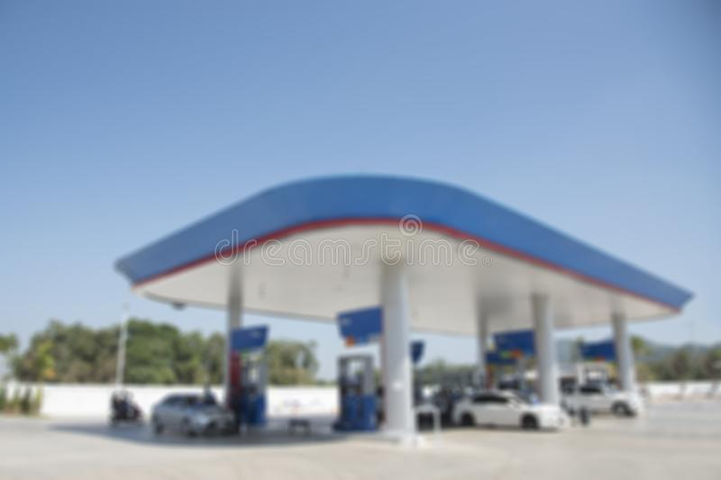 Blur image of gas station in day time.selective focus petrol pump station for background stock photo