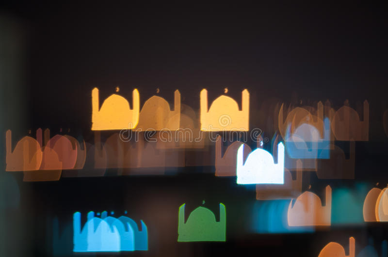 Blur image of Kuala Lumpur city, mosque bokeh shape with light trail. Bokeh has been defined as the way the lens renders out-of-focus points of light.Differences royalty free stock photos