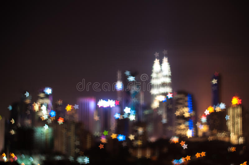 Blur image of Kuala Lumpur city, star bokeh shape. Bokeh has been defined as the way the lens renders out-of-focus points of light.Differences in lens royalty free stock photography