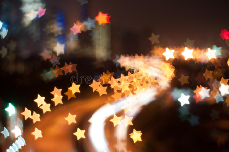 Blur image of Kuala Lumpur city, star bokeh shape. Bokeh has been defined as the way the lens renders out-of-focus points of light.Differences in lens stock photos