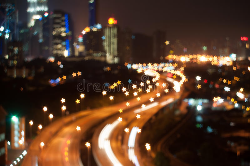 Blur image of Kuala Lumpur city, star bokeh shape. Bokeh has been defined as the way the lens renders out-of-focus points of light.Differences in lens stock image