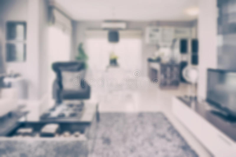 Blur image of modern living room interior with dining table and pantry stock photos