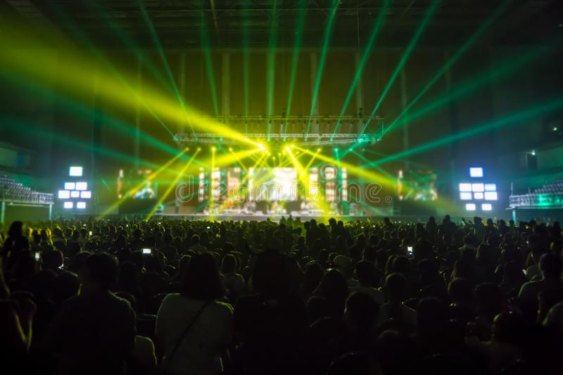 Music brand showing on stage or Concert Live and Defocused entertainment concert lighting on stage with Laser rays beams, party royalty free stock image
