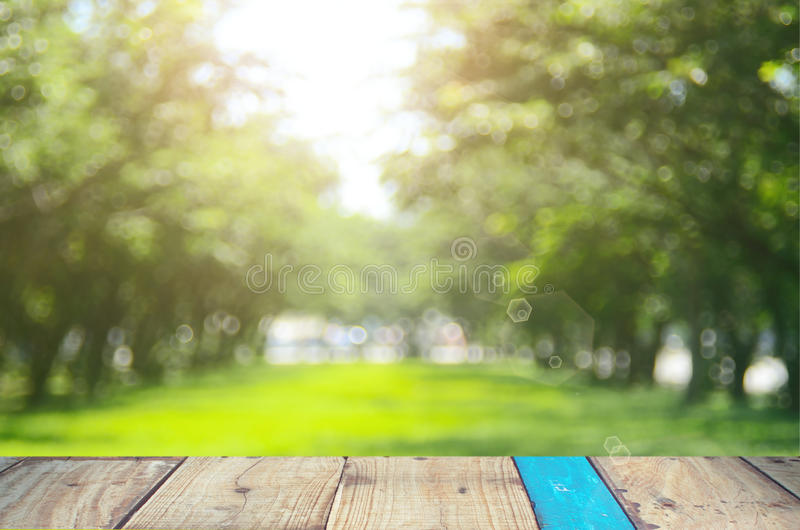 Blur nature green park abstract background. Blur nature green park with old empty table abstract background royalty free stock images