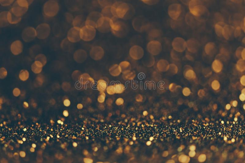 Blur neon gold light circle background. Sparkling firework bokeh dots in retro film filter style stock images