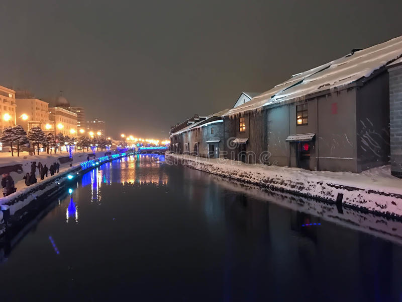blur of Night view and Light on Otaru canal, snow is stopping in royalty free stock photo