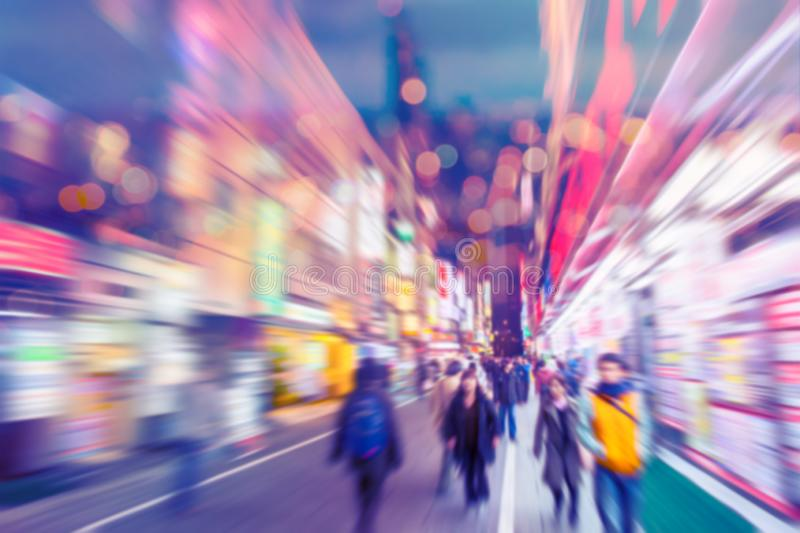 Blur people in colourful shopping street walking royalty free stock images